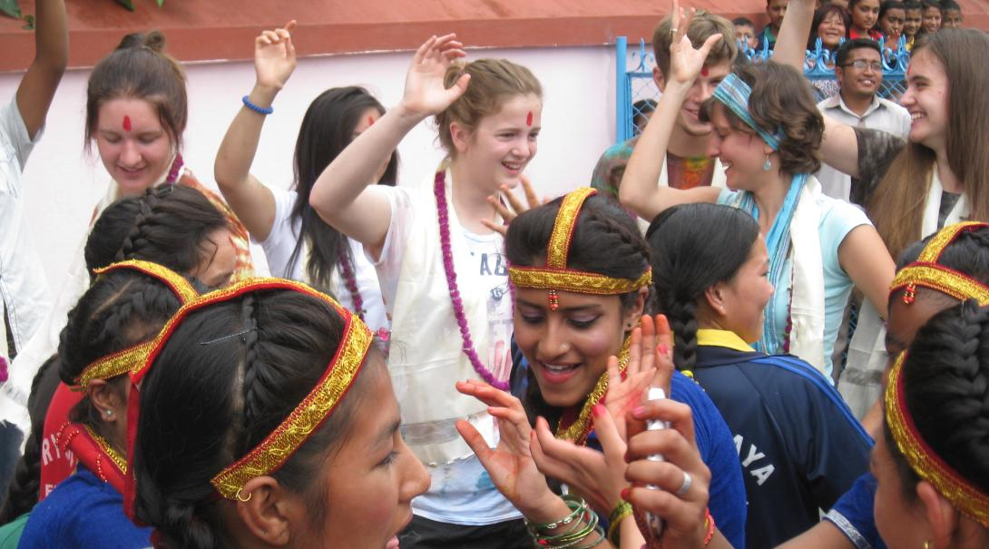 High school volunteers celebrate their last day in Nepal with a traditional dance